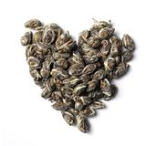 Heart shaped from pearl green tea  on white background Stock Image