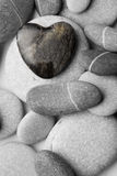 Heart Shaped Pebble on the Beach. A single heart shaped pebble on a nice shingle beach royalty free stock photography