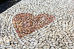 Heart shaped pebble pavement Royalty Free Stock Images