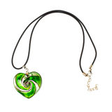 Heart-shaped pendant. Green heart-shaped pendant isolated on white background stock image