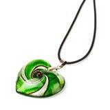 Heart-shaped pendant. Green heart-shaped pendant isolated on white background royalty free stock image