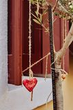Heart shaped pendant hanging on a tree branch as a symbol of love royalty free stock image