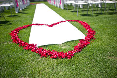 Heart-shaped petals of red roses. The wedding was the red rose heart-shaped petals Royalty Free Stock Image