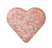 Heart-shaped pill Stock Image
