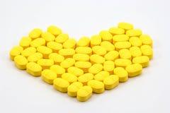 Heart shaped pill Stock Photos