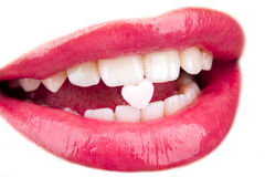 Heart shaped pill in woman's mouth Stock Photos