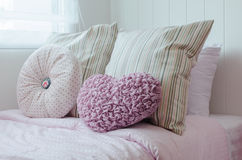 Heart shaped pillow on bed. At home Royalty Free Stock Images