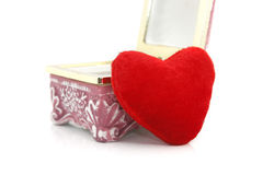 Heart shaped pillow with gift box Royalty Free Stock Photography