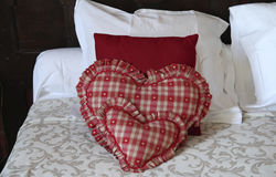 Heart shaped pillows in hotel room Royalty Free Stock Image