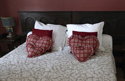 Heart shaped pillows in hotel room Royalty Free Stock Photo