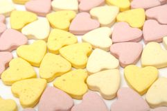 Heart-Shaped Pills. Heart-shaped multicolored pills as a background Royalty Free Stock Photos