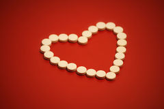 Heart shaped pills Stock Photo