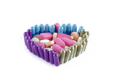 HEART SHAPED PILLS CLOSE UP Royalty Free Stock Image