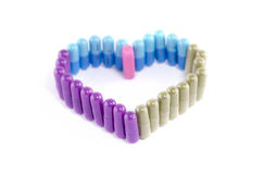 HEART SHAPED PILLS. Pills shaped together in the form of a heart on white background royalty free stock photography