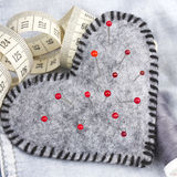 Heart shaped pincushion Stock Photography