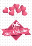Heart shaped pink balloons holding a square sign with a pink ribbon with the message FELIZ DIA DE SAN VALENTIN Royalty Free Stock Images