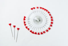 Heart shaped pins on white Royalty Free Stock Images