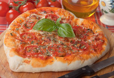 Heart shaped pizza margherita Royalty Free Stock Images