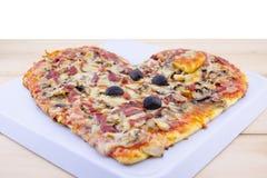 Heart shaped pizza Stock Image
