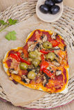 Heart shaped pizza Stock Images