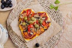 Heart shaped pizza Royalty Free Stock Photos