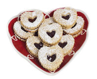 Heart shaped plate covered with heart cookies Royalty Free Stock Photos