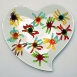 Heart shaped plate and colored candy royalty free stock photos