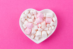 Heart-shaped plate with marshmallows Stock Images