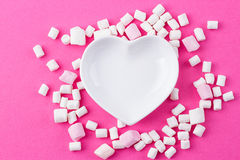 Heart-shaped plate with marshmallows Royalty Free Stock Image