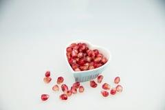 Heart  Shaped plate, pomegranate fruit, Stock Photo