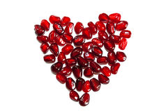 Heart shaped pomegranate stock image