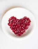 Heart Shaped Pomegranate Seeds Royalty Free Stock Photography