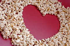 Heart shaped popcorn. Popcorn forming the shape of a heart stock photo