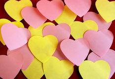 Heart shaped post it. Background of many heart-shaped colorful post its over red royalty free stock photography