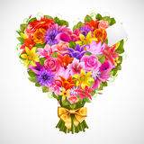 Heart shaped posy. Of tender flowers with golden bow Royalty Free Stock Images