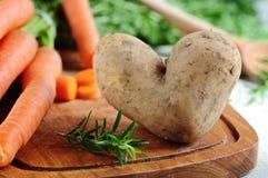 Heart shaped potato Stock Photo
