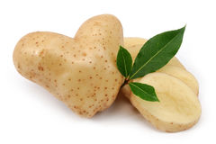 Heart shaped potato and slices Stock Photos