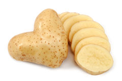 Heart shaped potato and slices Stock Photo