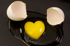 Heart shaped raw egg yolk Stock Photography