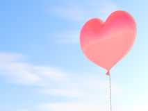 Heart shaped red balloon. With blue sky background Royalty Free Stock Photo