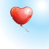 Heart shaped red balloon in the sky to the Valentines day. Stock Photo