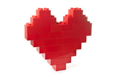Heart shaped red building blocks. Red building blocks shaped as a heart over white background stock photos