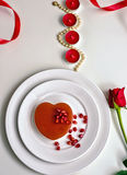 Heart shaped red cake on a white plate. Delicious dessert for Valentine`s Day Romantic dinner Royalty Free Stock Images