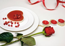 Heart shaped red cake on a white plate. Delicious dessert for Valentine`s Day Romantic dinner Stock Photos