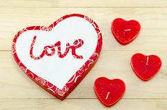 Heart shaped red candles and a box Royalty Free Stock Images