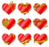 Heart-shaped red cards. Set of beautiful heart-shaped red cards with gold gift bows with ribbons. Vector illustration Royalty Free Stock Photography