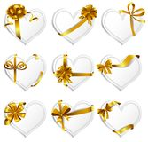 Heart-shaped red cards. Set of beautiful heart-shaped cards with gold gift bows with ribbons. Vector illustration Royalty Free Stock Photography