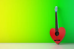 Heart shaped red guitar against green wall Stock Photos