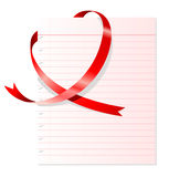 Heart shaped red ribbon. With notepad Royalty Free Stock Photos