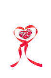 Heart shaped red ribbon with metal wire heart Royalty Free Stock Photography